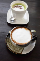 cup of hot coffee with green tea