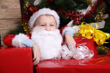 Boy Santa Claus with Christmas gifts