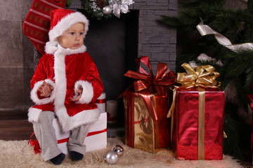 baby Santa Claus with Christmas gifts
