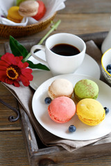 delicious macaroon on a plate with coffee