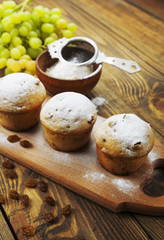 Homemade muffins with raisins and powdered sugar