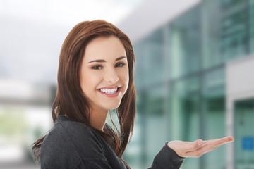 Woman showing copyspace