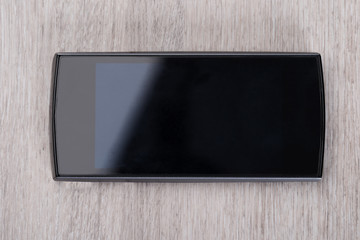 Smartphone At Wooden Table