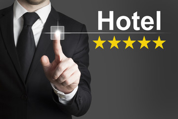businessman pushing button hotel golden rating stars