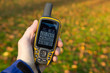 Hand held outdoor GPS used in autumn. - 73507789