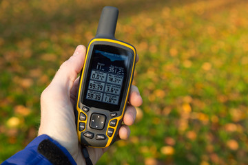 Hand held outdoor GPS used in autumn.
