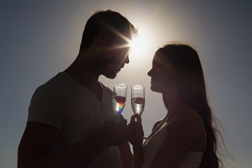 Cute couple toasting with champagne