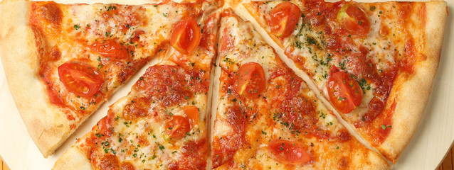 Delicious pizza on wooden plate