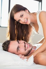 Young couple having fun in bed