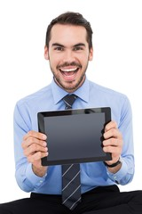 Happy businessman showing his tablet pc