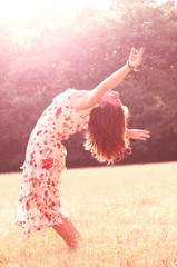 Free happy woman dancing at forest background
