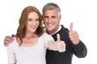 Leinwanddruck Bild - Casual couple showing thumbs up