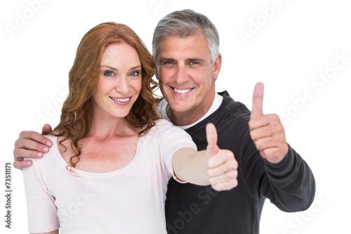 Leinwanddruck Bild Casual couple showing thumbs up