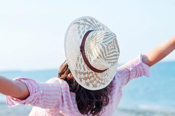Free happy woman enjoying at sea background