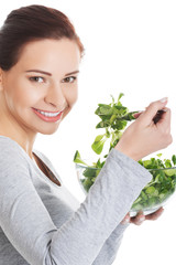 Portrait of a woman eating lettuce from bowl