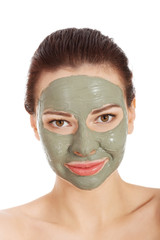 Portrait of a woman in green face mask