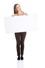 Full length happy woman holding an empty baner