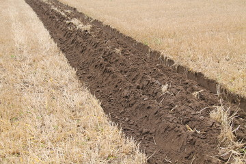 Ploughed Deep Furrows on a Farmers Field.