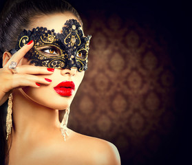 Beauty model woman wearing masquerade carnival mask