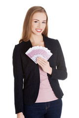 Businesswoman holding a clip of dollars