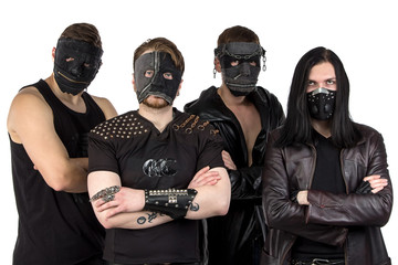 Portrait of the metal band in masks