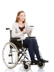 Young woman in wheelchair holding a tablet