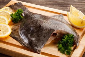 Fresh raw flounder on cutting board