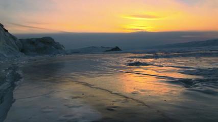 Winter lake landscape at sunset