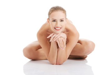 Front view nude woman sitting propping head