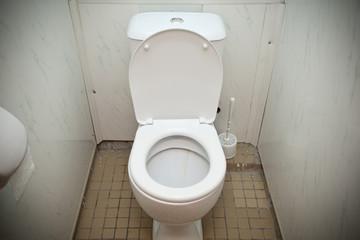 Cheap white toilet in a bathroom