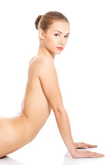 Naked woman in bent yoga pose