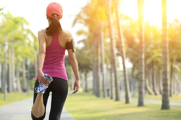 woman runner warm up at tropical park