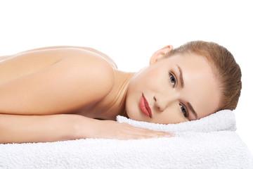 Woman lying on towel ready to massage