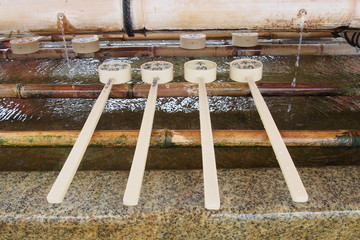 Ladle on the Traditional water well in Japan
