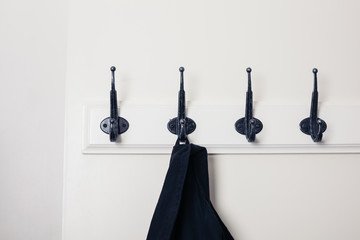 Row of hooks with jacket