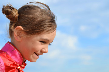 Cute little girl laughing in the sky