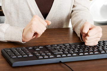 Close up woman typing on a pc keyboard