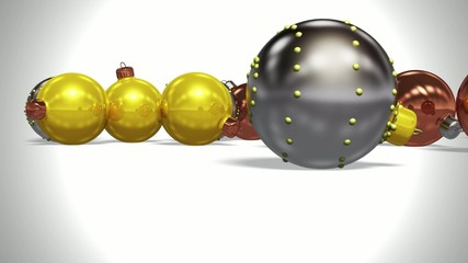 Christmas balls falling on a flat surface