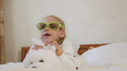 Children wearing passive 3d glasses watching TV