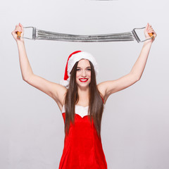 Young woman in santa hat with expander