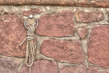 knot on a brick wall