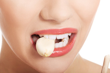 Close up on woman mouth eating garlic