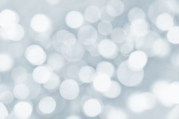 Holiday silver background with blurred bokeh lights