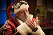 Bad Santa smoking a joint