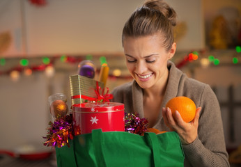 Young housewife with christmas shopping bag