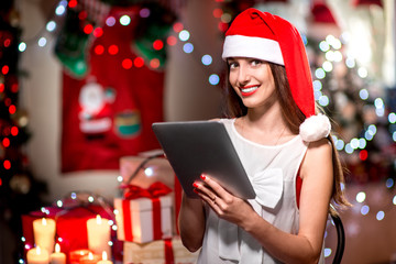 Young woman using tablet on Christmas