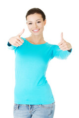 Happy woman gesturing thumbs up