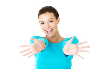 Portrait of a happy woman with open hands gesture