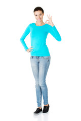Full length woman showing ok sign