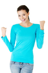 Full length woman making winner gesture